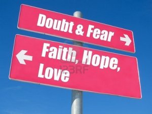 9156157-faith-hope-love-vs-doubt-fear-signpost-against-blue-sky